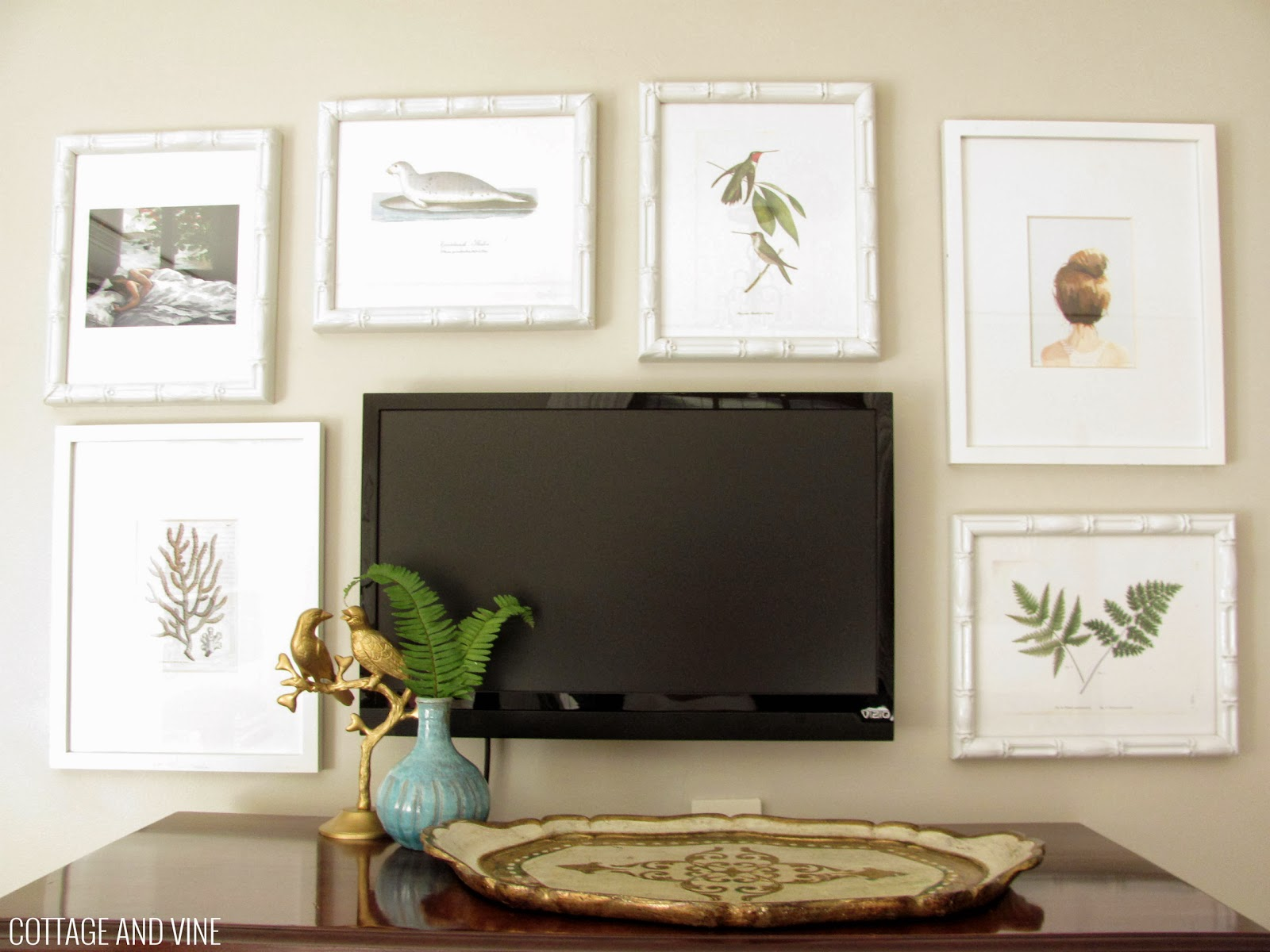 Integrate Your Tv Within A Wall Of Picture Frames